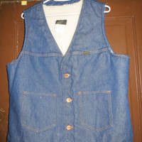 Vintage 1970's blue jean vest lined in sherpa fleece.  Made by Maverick. sz large