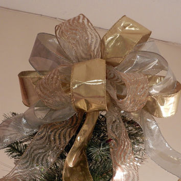 Large  Christmas Tree topper bow made of both gold and silver lame' ribbon and a sheer ribbon with gold and silver zebra stripes