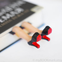 Legs in the book. Louboutin shoes. Halloween . Elegant high fashion gift. Black and red . oht summer desk accessory