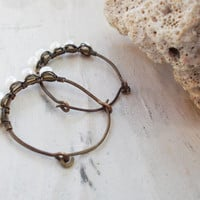 White freshwater pearl stirrups, wire wrapped hammered hoops, oxidized brass, primitive artisan jewelry, organic style beach wear