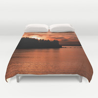 Photo of Sun Setting Over the Ocean Duvet Cover by GriffingPhotography