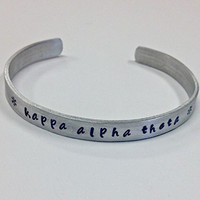 Kappa Alpha Theta Cuff Bracelet - handstamped in a whimsical font on a non tarnish aluminum cuff, officially licensed