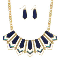 Gold tone bib style necklace featuring a navy blue and teal tone focal with chevron decor and matching 1 1/2 fishhook style earrings.