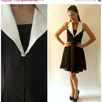 STOREWIDE SALE 50's style vintage Marilyn Monroe black party dress with white collar and deep v neck rhinestone detail. size 8 medium