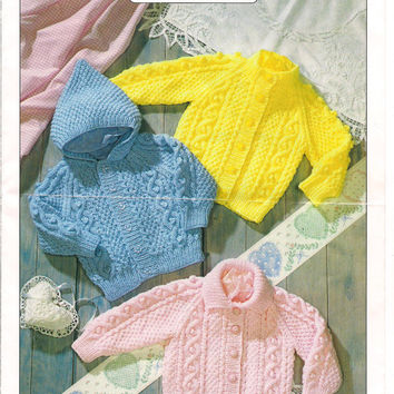 Baby Aran Cardigan Knitting Pattern PDF instant download. Pattern for a cardigan with a neckband, collar or hood.