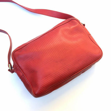 LANVIN!!! Vintage 1980s 'Lanvin' red leather oblong shaped shoulder bag with zippered opening and scored decorative panels