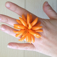 Orange acrylic ring created from up-cycled vintage clip on earring