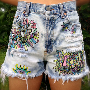 Vintage, high waisted, acid washed and hand painted cut offs, with a  Peace & Love design. Button fly Calvin Klein vintage jeans