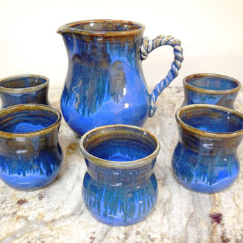 Hand thrown pitcher set in rich blue and ancient jasper glazes on white stoneware clay with 5 stemless cups