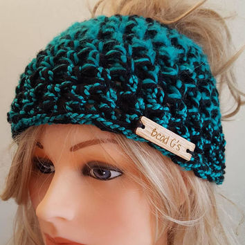 Crochet bun hat. Made by Bead Gs on ETSY.  Ladies Size.