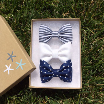 Grey and white striped, white denim, and blue polka dot hair bows Seaside Sparrow.  Seaside Sparrow bows make the perfect gift.