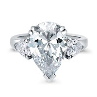 A Perfect 5.8CT Pear Cut Russian Lab Diamond Ring with Heart Accents