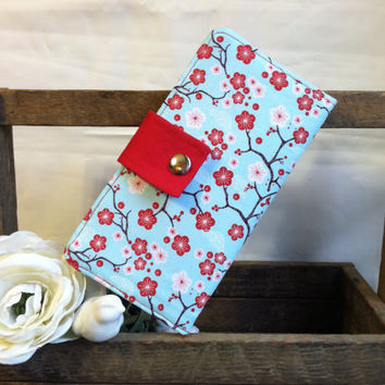 Bright floral red blossoms with white, and blue background wallet with card slots, coin pouch