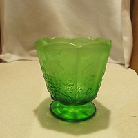 VINTAGE GREEN VASELINE GLASS VASE WITH A LEAF AND BERRY DESIGN