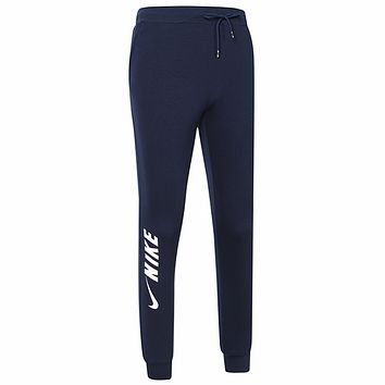 NIKE 2018 autumn and winter new men's knitted sports casual trousers Dark blue
