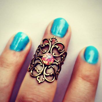 pink fire opal above the knuckle ring