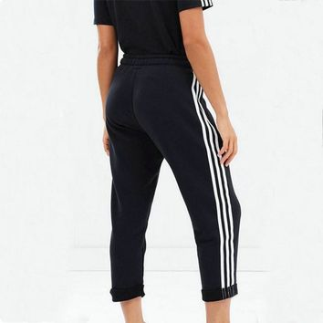 adidas originals black three stripe cropped sweatpants with roll hem