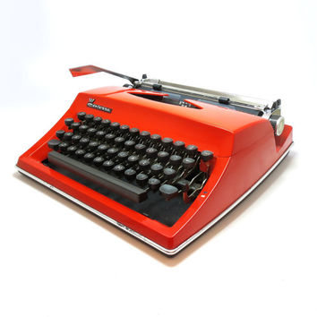 1970s Red Orange Working Vintage Manual Contessa Typewriter. In Good Cosmetic Condition. Case Included.