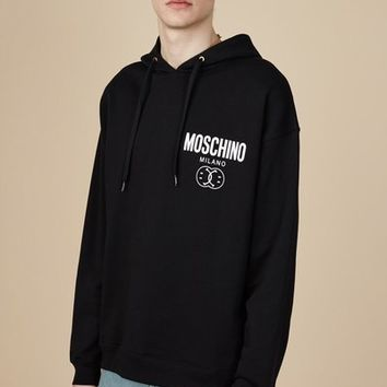 Moschino Smiley Face Printed Moschino Hoodie - MEN - SALE - Moschino - OPENING CEREMONY