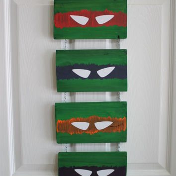Hand painted Teenage Mutant Ninja Turtles sign painted on reclaim wood with a chain hanger.