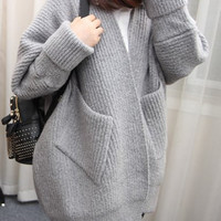 Collarless Double Pocket Knitted Cardigan