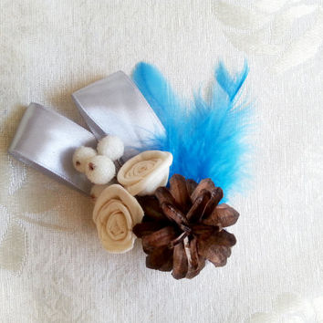 Winter wedding frozen wonderland boutonniere/corsage Cream Flowers, pine cones, feathers, frozen fruits, sola roses, blue