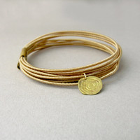 Golden bangle, Minimalist ethnic bracelet, Cotton cord and brass Stacking bangles