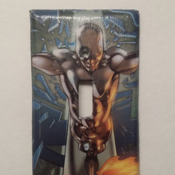 Light switch plate covered in Silver Surfer printed sheet