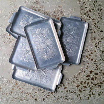 Vintage Embossed Aluminum Tip Trays Trays Set of Eight Four by Seven Inch