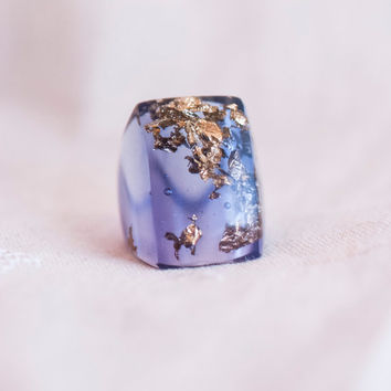 Light blue ring with gold flakes