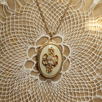 Vintage Victorian Style Locket In Gold Tone And Cream Enamel With Flower Detail