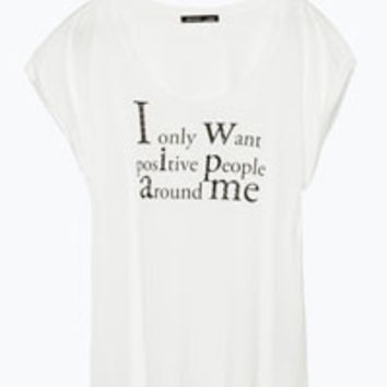 T-SHIRT WITH TEXT AND DIAMANTE