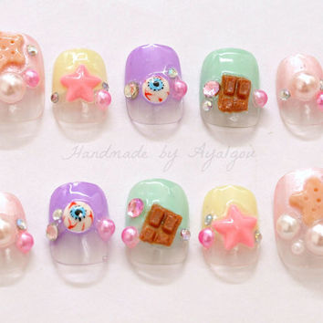 Kawaii nails, fairy kei, pop kei, pastel, summer fashion, eyeballs, fake sweets, stars, pearls, gems, Japanese street fashion