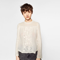 EMBROIDERED TOP WITH HIGH NECKDETAILS