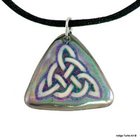 Celtic Trinity pendant, hand-crafted porcelain, unique neutral colors with hints of green & purple, platinum trim on a black satin cord.