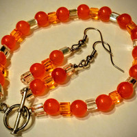 Bracelet, earrings, orange beaded set, Halloween and fall colors, custom size bracelet, round, orange topaz, square clear and orange beads