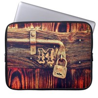 Old wood door, brass lock and bolt laptop sleeve