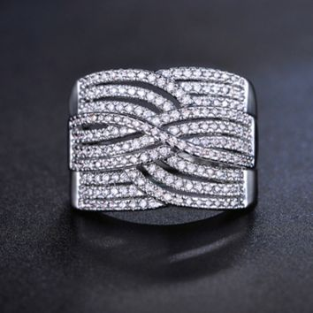 IMPRESSIVE CRISS CROSS BAND MICRO PAVED WHITE GOLD PLATED RING