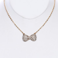 NECKLACE / PAVE CRYSTAL STONE / METAL BOW PENDANT / LINK / CHAIN / 16 INCH LONG / 1/2 INCH DROP / NICKEL AND LEAD COMPLIANT