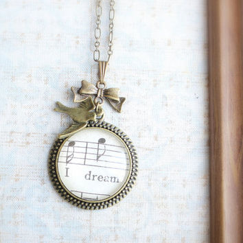 Music and bird charm necklace.  Vintage style jewelry made with antique sheet music. Romantic pretty accessory