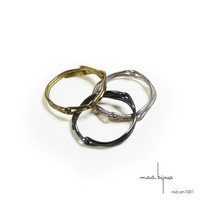 3 stackable wedding ring: 1 whited sterling silver ring, 1 black oxidized sterling silver ring, 1 yellow 18kt gold ring