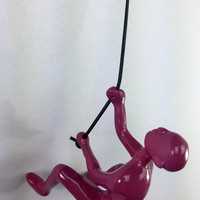 Climbing man wall art Silver buy 4 @ asking price get 1 FREE buy more get more FREE Purple