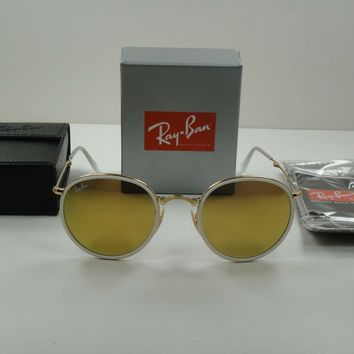 824d4a38edf RAY-BAN ROUND FOLDING SUNGLASSES RB3517 001 93 GOLD FRAME YELLOW