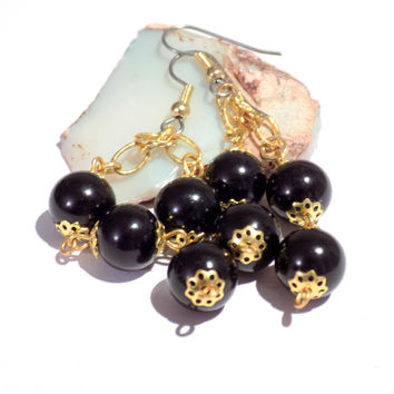 Black and gold dangly earrings