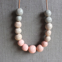Handmade ceramic strand necklace - fading pink, cream and gray beaded necklace - beadwork on leather cord