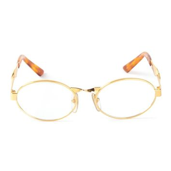 Moschino Vintage oval frame glasses