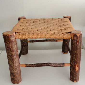 Rustic foot stool or ottomon with hand woven top and branch frame