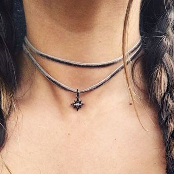 Smokey velvet double-wrap choker with paved starburst charm