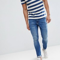 River Island Super Skinny Jeans In Mid Wash at asos.com