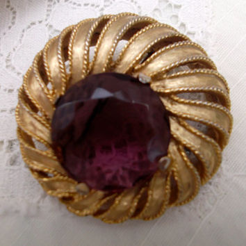 Beautiful vintage signed  Sphinx gold tone brooch with amethyst coloured stone.Ideal gift for , birthday, anniversary